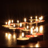 Photograph of candles on black background
