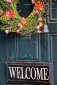 Old weathered door with welcome sign