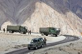 JAMMU & KASHMIR, INDIA - SEPTEMBER 04, 2011: Indian army convoy of trucks delivering supplies to rem