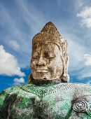 stock photo of asura  - Asura statue on blue sky background - JPG
