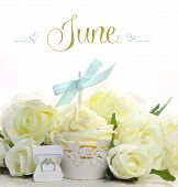 Beautiful White June Bride Theme Cupcake With Seasonal Flowers And Decorations For The Month Of June
