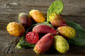 stock photo of prickly pears  - prickly pear on wood - JPG