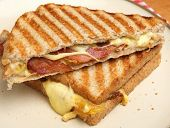 Toasted sandwich with bacon, egg and cheese