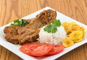 pic of lamb shanks  - Angles of the traditional stewed lamb made and served the Cuban way - JPG