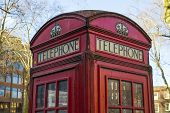 Close up of old red telephone booth in London, UK
