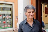 VENICE, ITALY - JUNE 12, 2011: close-up portrait of waiter. Venice is a city in northeastern Italy s