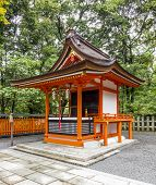 Traditional Shinto Architecture And Stone Lanterns At Fushimi Inari Shrine In Kyoto, Japan