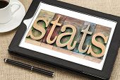 stats (statistics) - a word in vintage letterpress wood type printing blocks on a digital tablet wit