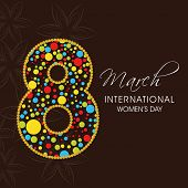 International Happy Women's Day celebration concept with stylish colourful text 8th March on brown background.