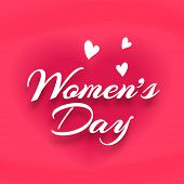 Happy Women's Day celebrations concept with stylish text on heart shape decorated pink background.