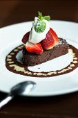 Piece Of Chocolate Cake With Icing, Whipping Cream And Fresh Strawberries
