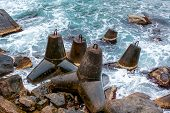 Antique Iron Groynes On The Sea Shore