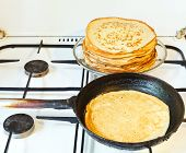 Baked Pancake And Stack Of Prepared Pancakes