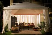 picture of banquette  - Garden party or wedding entertainment tent in garden at night - JPG