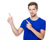 Young man with two finger point up