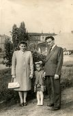 SIERADZ, POLAND, CIRCA FIFTIES - Vintage photo of parents with their daughter
