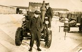 SIERADZ, POLAND, CIRCA SIXTIES - Vintage photo of farmers with a tractor