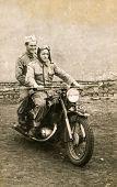 SIERADZ, POLAND, CIRCA SIXTIES - Vintage photo of two men on motorbike
