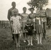 SIERADZ, POLAND, CIRCA FIFTIES - Vintage photo of two soldiers with their wives and children