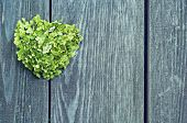 foto of broken heart flower  - green heart of flowers on a background of a wooden fence - JPG