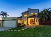 stock photo of in front  - Modern new australian home front at dusk - JPG