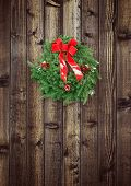 Christmas Wreath On Rustic Wooden Fence
