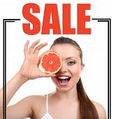 Concept of discount. Beautiful girl with grapefruit, isolated on white