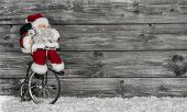 Funny Santa Buying Christmas Presents Decorated On Wooden Background.