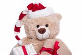 Smiling Portrait Teddy Bear Wearing Christmas Hat With Gift Boxes On White Background