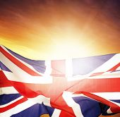 Union Jack flag in front of bright sky