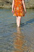 Woman wading through sea water