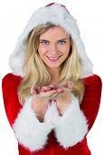 Pretty girl in santa outfit with hands out on white background