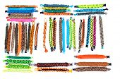 Selection of Parachute cord bracelets with a variety of colors and weaves on a white background