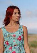 Redhead Girl Standing At The Seashore
