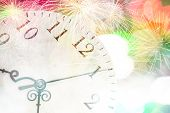 Conceptual image with pocket watch bokeh lights and fireworks
