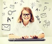 education, school and future technology concept - little student girl with keyboard and imaginary sc