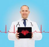 medicine, profession, and healthcare concept - smiling male doctor with stethoscope showing tablet p