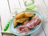 gnocco fritto with parma ham, traditional parma recipe
