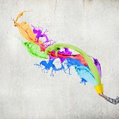 Close up of hand splashing colorful paint from bucket