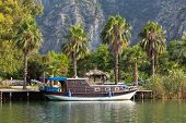 stock photo of dalyan  - An old Boat in Dalyan River - JPG