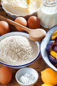 foto of baking soda  - Many ingredients such as butter flour plums baking powder and milk for crumble Plum Cake - JPG