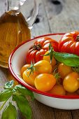 Tomatoes In A Bowl, Basil And Olive Oil