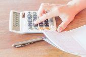 Businesswoman Calculated Account Balance