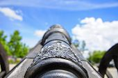 pic of battlefield  - Battlefield Metal Cannon With Blue Sky Background