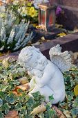 Autumn Decoration On The Tomb With White Angel.