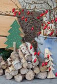 Natural Wooden Christmas Decoration With Red Rosehips.