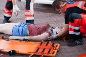 picture of breath taking  - Emergency service taking woman after accident horizontal - JPG