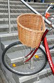 Bicycle with wicker basket.