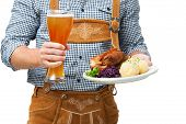 pic of waiter  - Food and drinks are served by waiter wearing traditional Bavarian leather trousers - JPG