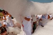 People Walk Through Cloud Of Foam At Bubble Palooza Event